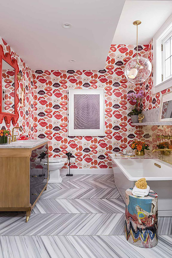 Striped tile pattern in bathroom with bright pink patterned wallpaper